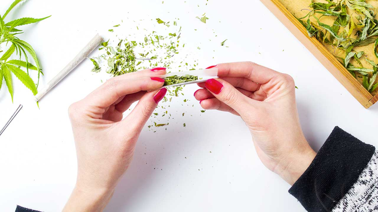 Bud Lab control your high, woman rolling up a joint