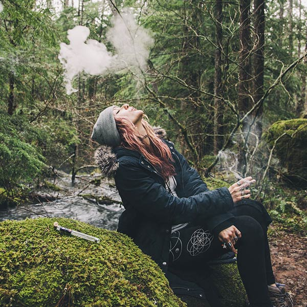 BudLab Woman Smoking In a Forest