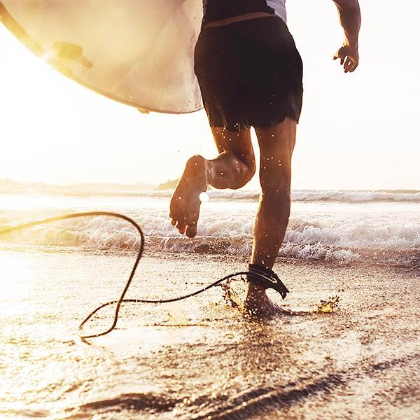CBD Oil Block of a man running in the sand