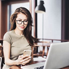 Woman on phone using the Bud Lab Rewards Program