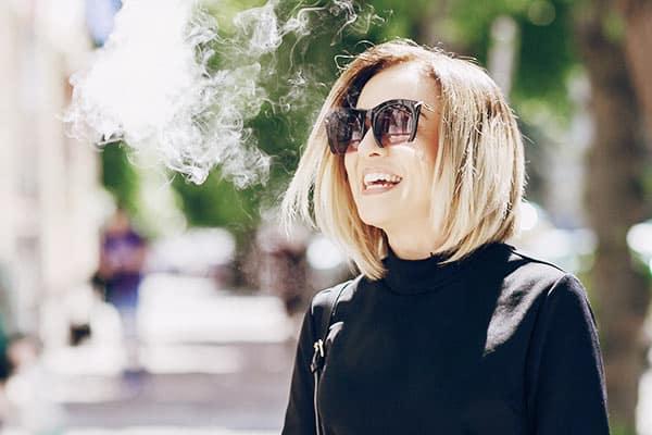 Woman Exhaling Cannabis Smoke