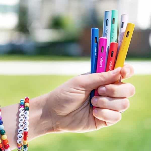 Holding Multiple Different Culture Vape Pens