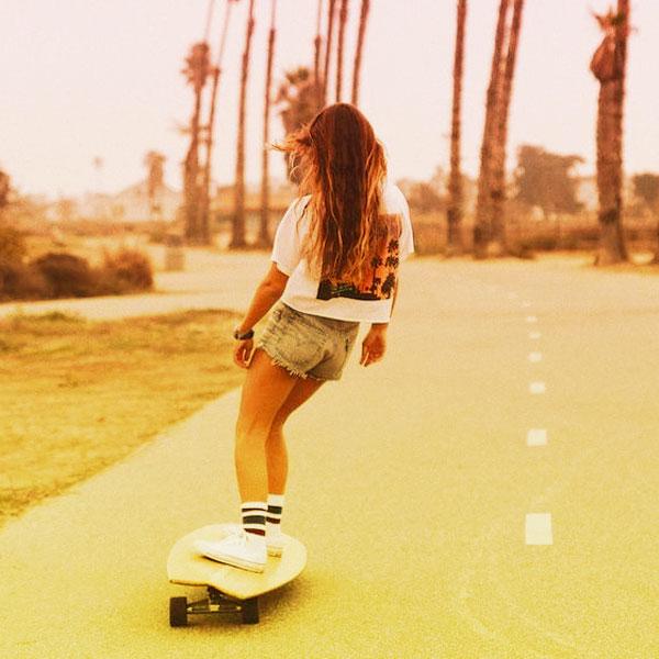 Woman On A Skateboard