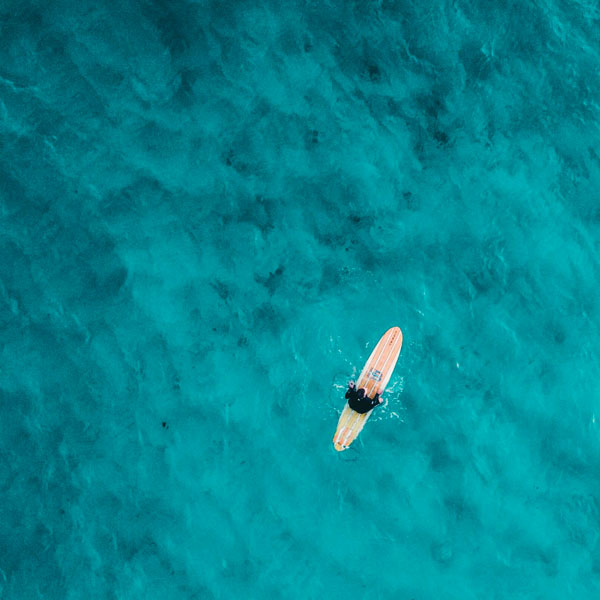 Birds Eye View of Surfer On Water