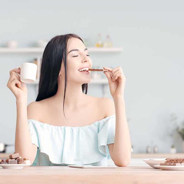 Woman Eating Microdose Chocolate