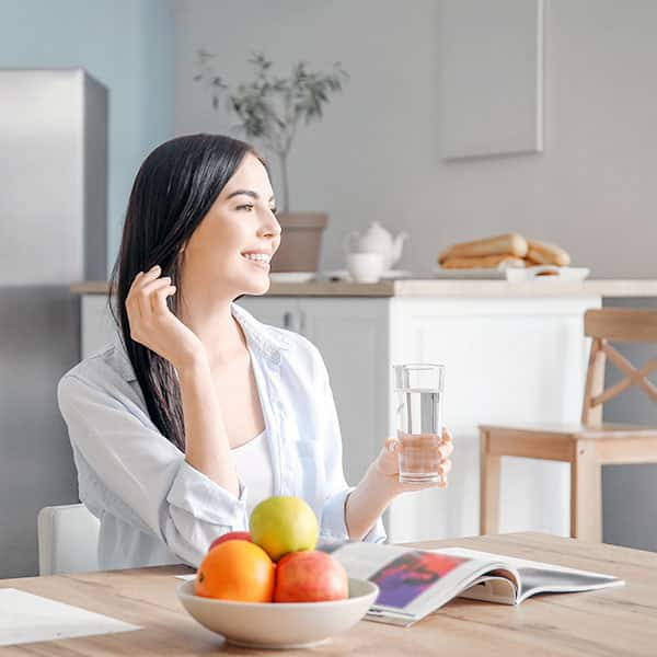 Woman Drinking Water With Fruits